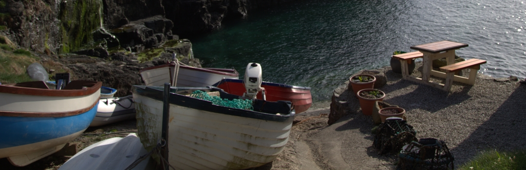 Boats on the shore at Church Cove